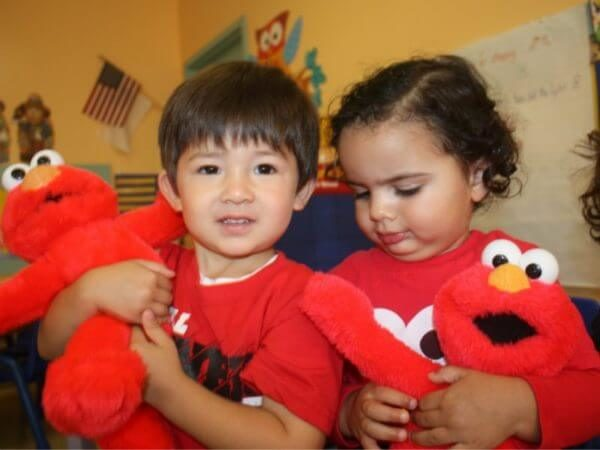 Both of them love their Elmo dolls