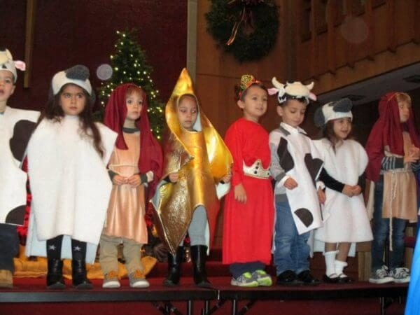 Preschoolers in various costumes at Christmas program