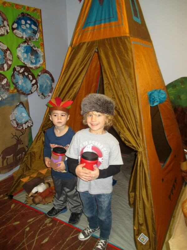 Two boys in costumes celebrating Native Americans