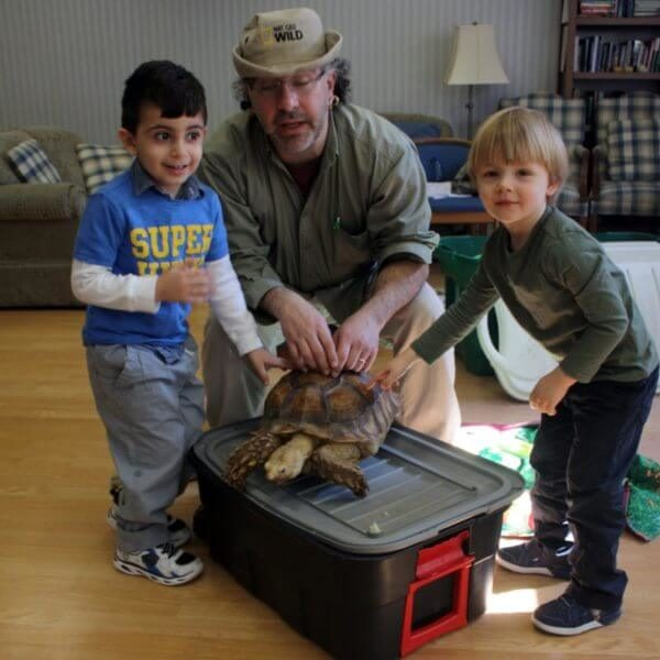 Two boys and a naturalist learn about turtles
