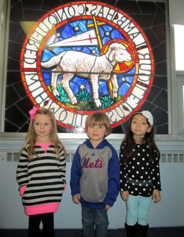 Children standing in front of Moravian Seal