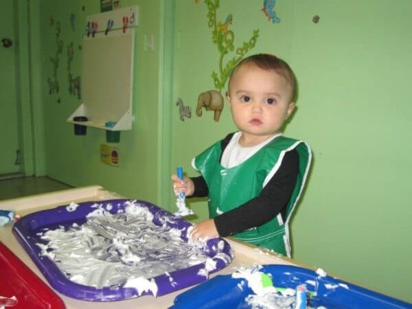 Toddler having shaving cream fun