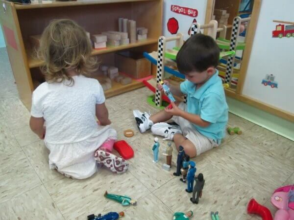 Twos stretching their imaginations with toys